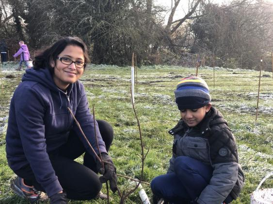 Mary and son planting trees in Oxford
